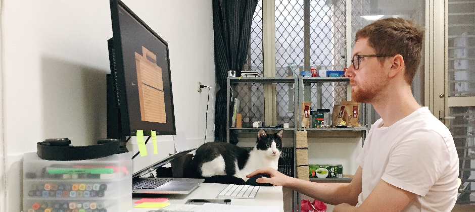 Ben working and Charlie staring lovingly at him.